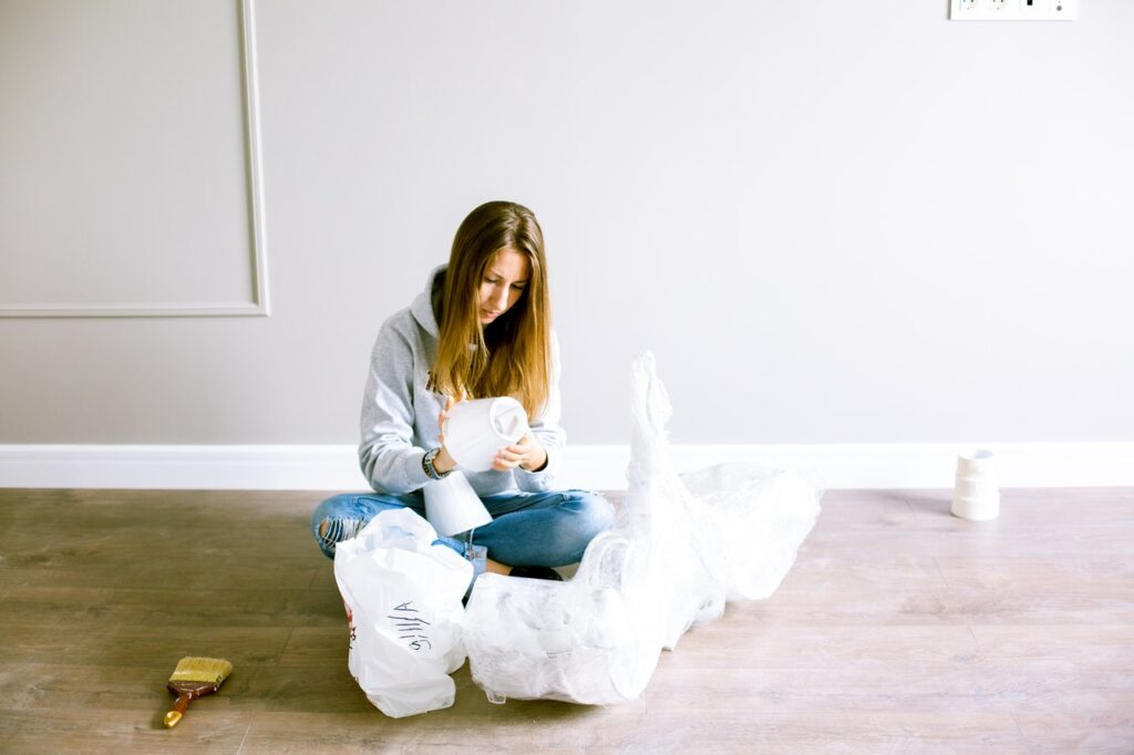 A woman sitting down and packing